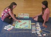 Photo of children playing Monopoly