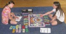 Photo of children playing Cashflow